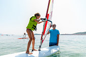 Little girl receiving her first windsurf lessons
