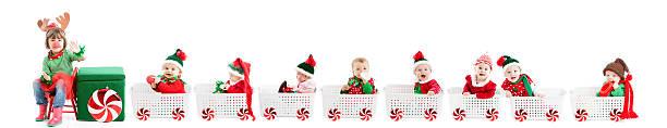 kleines mädchen rentier drives zug von verschiedenen baby elves - festzugskleidung stock-fotos und bilder