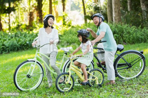 istock Little girl riding bicycles with grandparents 509680839