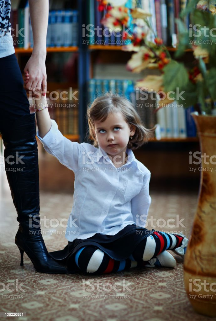 Little Girl Rolling Eyes and Holding Hands with Woman royalty-free stock photo