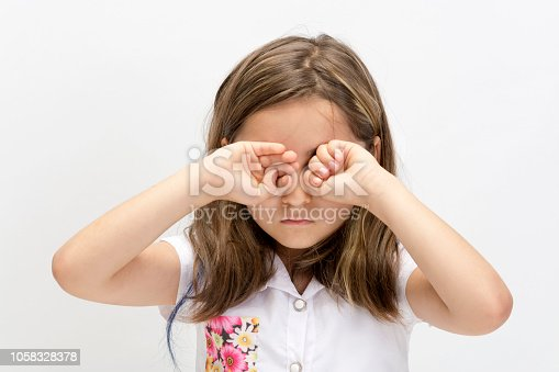istock Little girl rubbed her eyes 1058328378