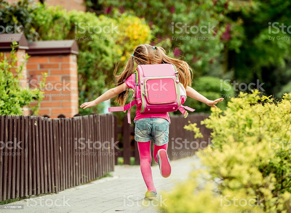 little girl  run to school stock photo