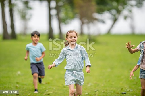 istock Little Girl Running at the Park 488630646