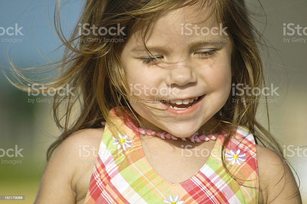 Little girl running in field royalty-free stock photo