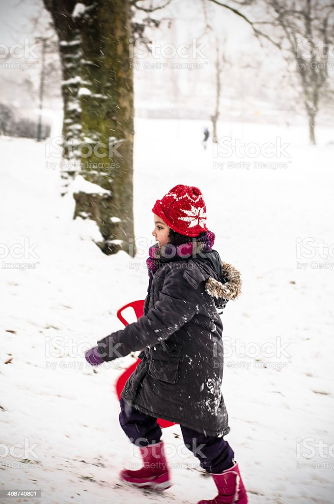 PEOPLE: Little Girl Running In Snow royalty-free stock photo