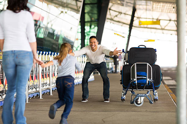 little girl running to her father at airport - reunion stock photos and pictures