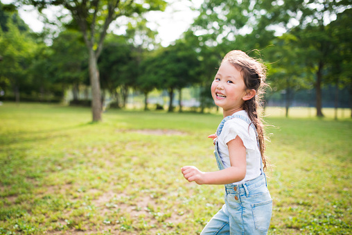 Little girl running while laughing