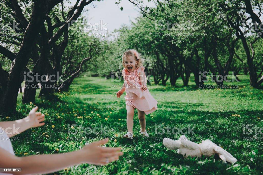 Little girl runs to meet mother. stock photo