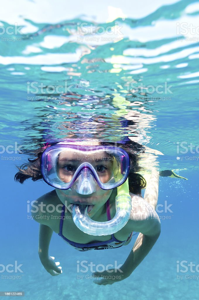 Little girl scuba diving in pool stock photo