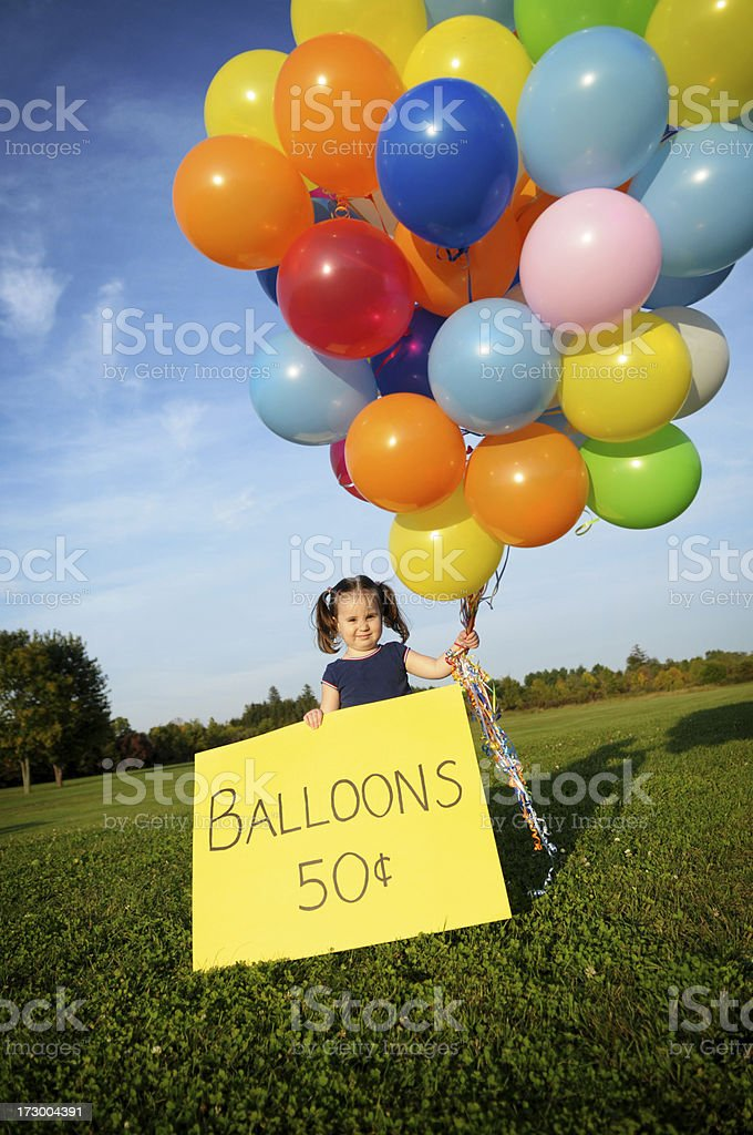 Little Girl Selling Balloons Outside royalty-free stock photo