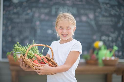 Little Girl Selling Carrots