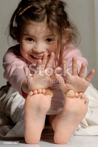Little Girl Showing Her Hands And Feet Stock Photo & More ...