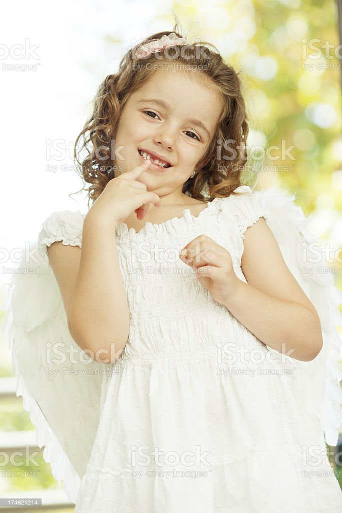 Little Girl Showing Missing Teeth. stock photo