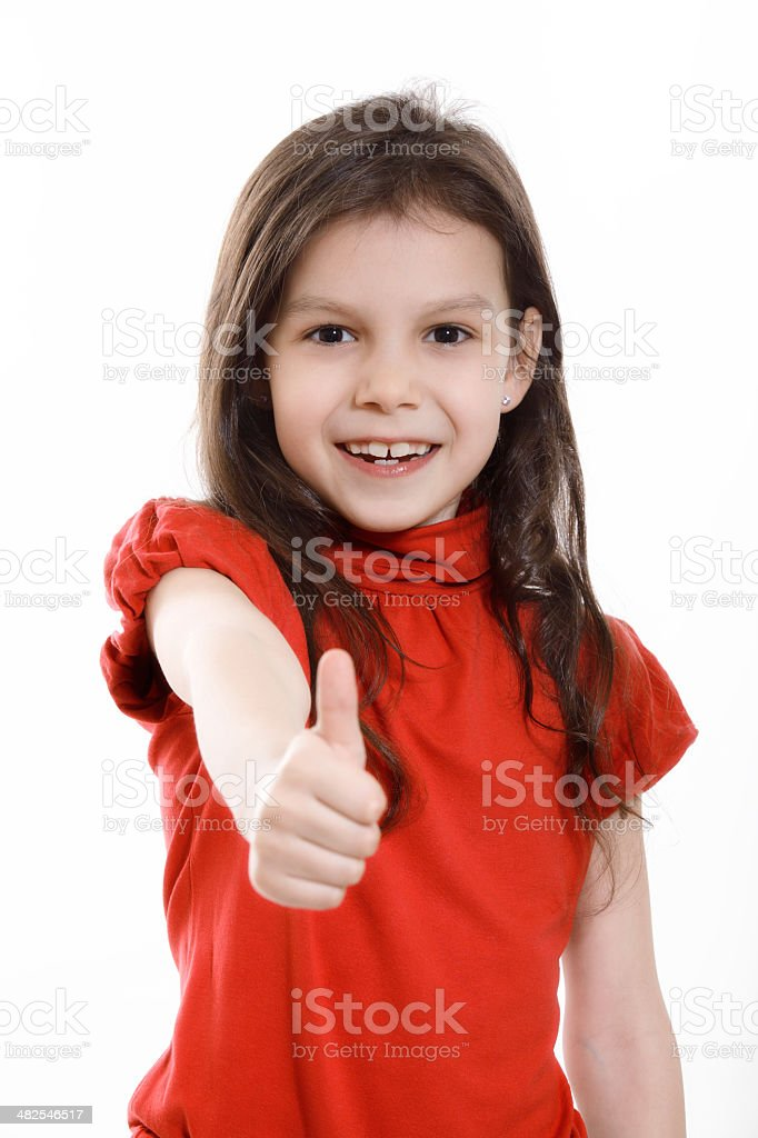 Little girl showing thumb stock photo
