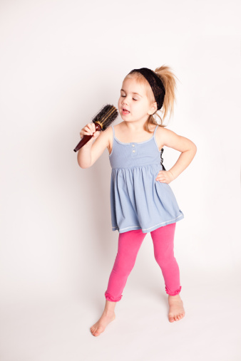 Little Girl Singing Into A Brush Stock Photo - Download ...