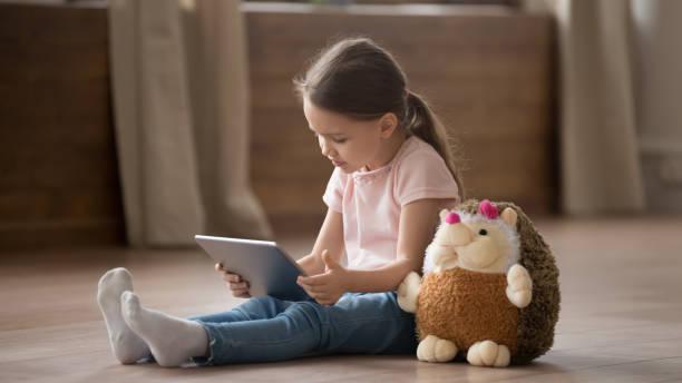 Little girl sit with hedgehog toy using tablet at home picture id1163242807?b=1&k=6&m=1163242807&s=612x612&w=0&h=gkk xzktg1aowwefitn6owt3yt1jc23xcilt37yn3iu=