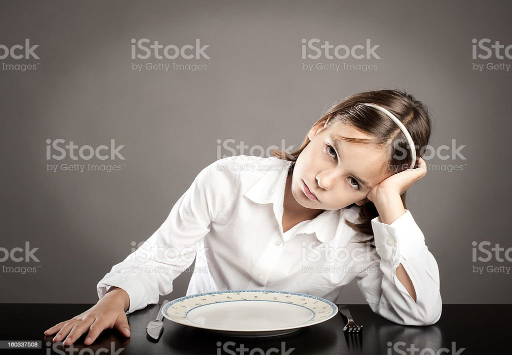 little girl sitting at table royalty-free stock photo