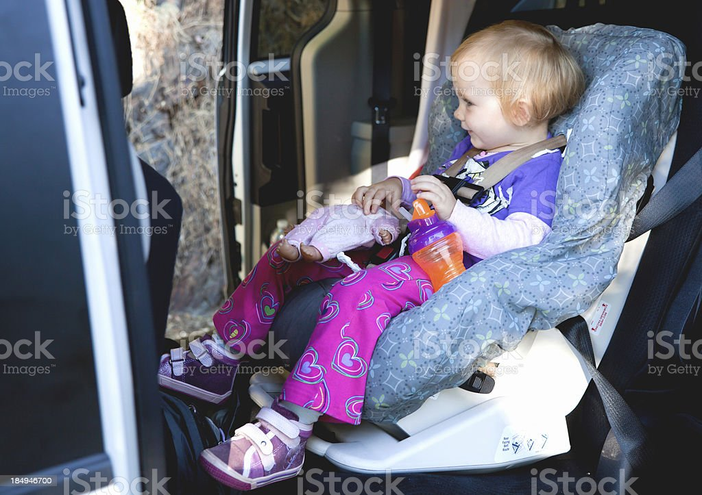 Little girl sitting in car seat royalty-free stock photo