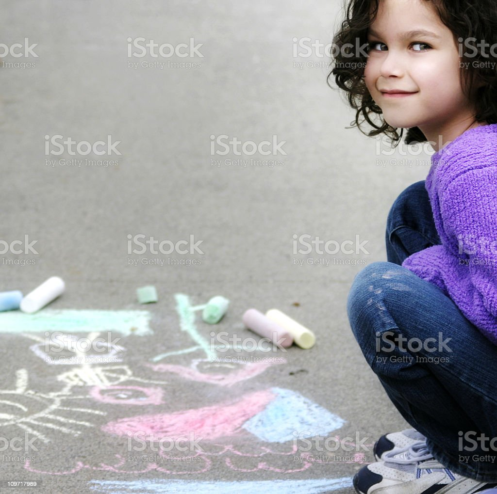 Little Girl Sitting Near Chalk Drawings royalty-free stock photo