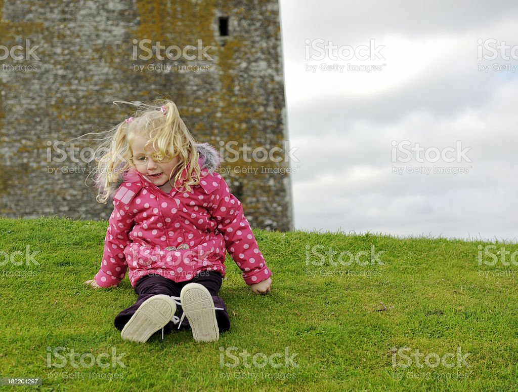 little girl sitting on a hill royalty-free stock photo