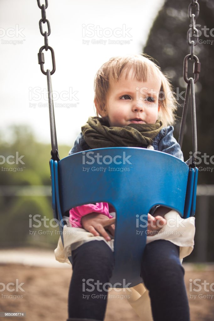 Little girl sitting on a swing royalty-free stock photo