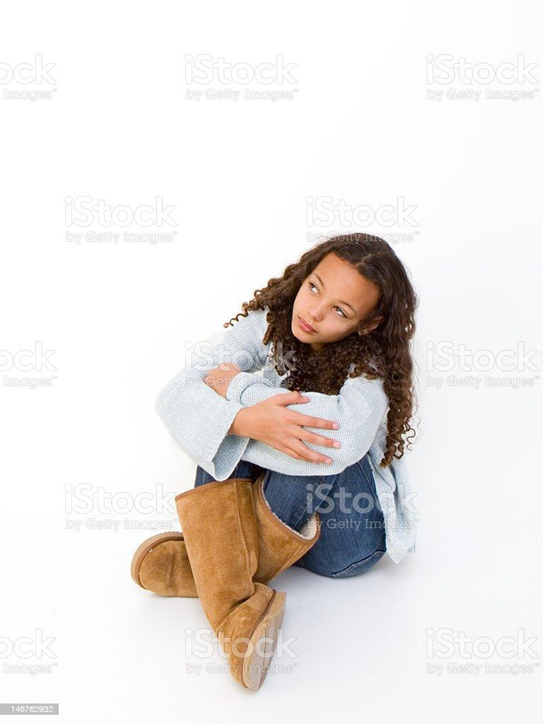 Little Girl Sitting on Floor stock photo