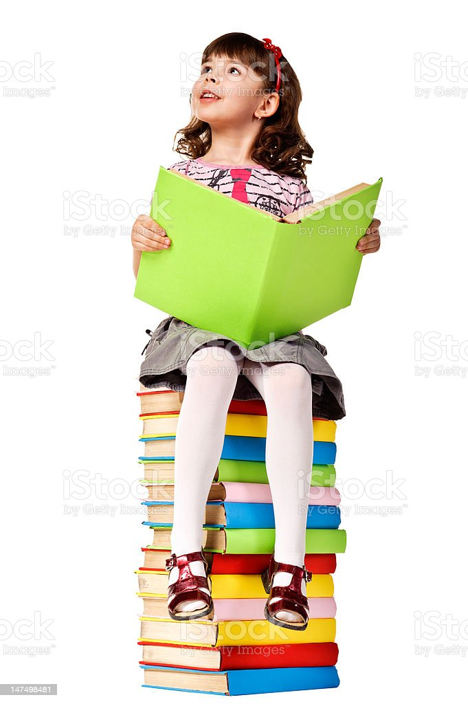 Little girl sitting on stack of books. royalty-free stock photo