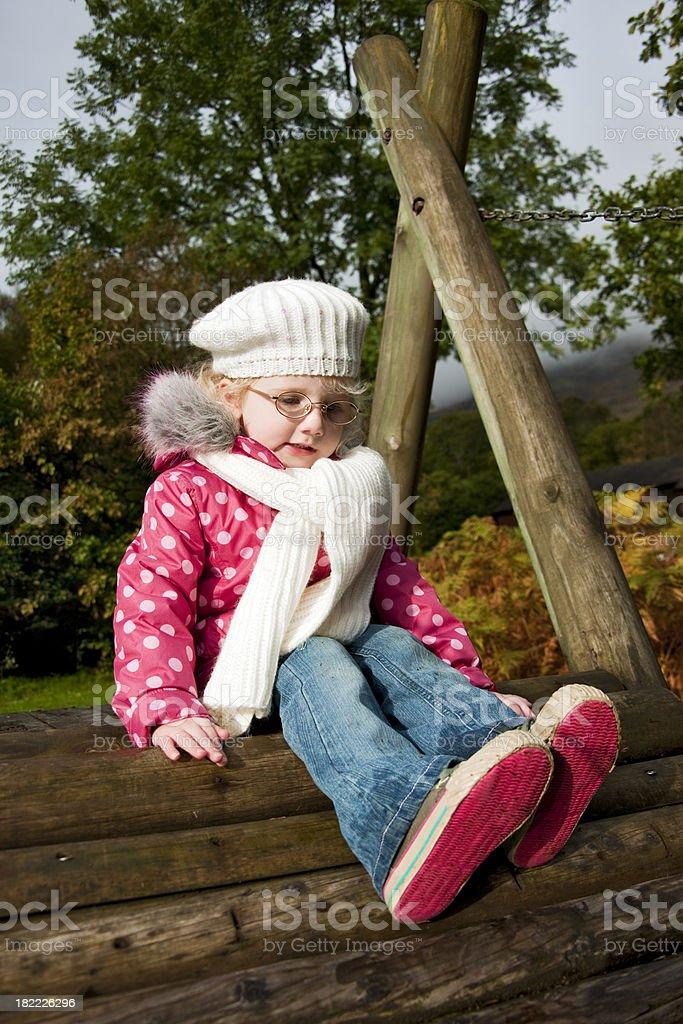 little girl sitting waiting royalty-free stock photo