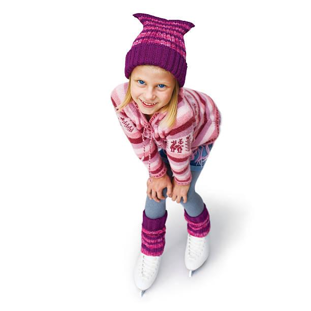 Little girl skating to ice skating. Isolated on white background stock photo