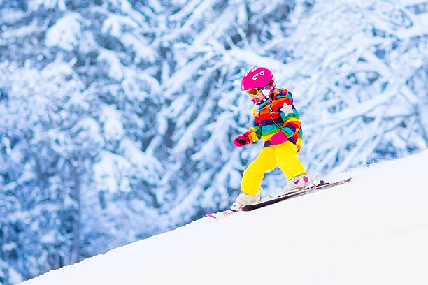 little girl skiing in the mountains - winter austria train bildbanksfoton och bilder