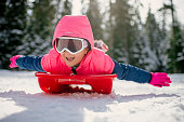 Cute little girl have fun on snow