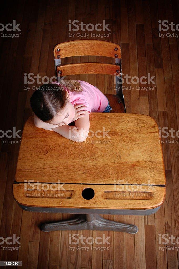 Little Girl Sleeping in a School Desk royalty-free stock photo