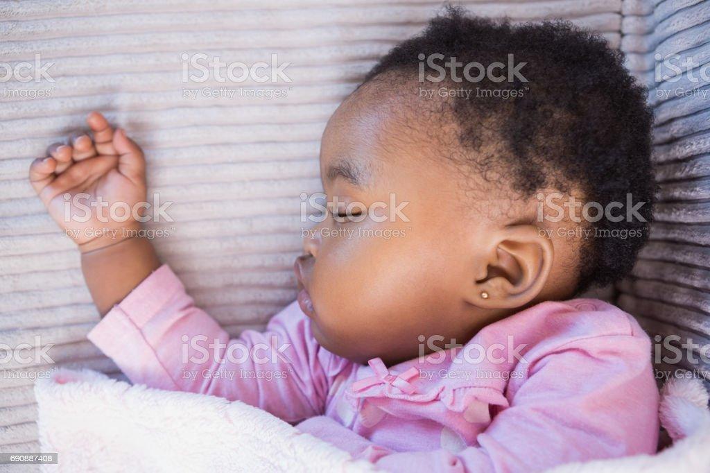 Little girl sleeping on the sofa Little girl sleeping on the sofa on living room African Ethnicity Stock Photo