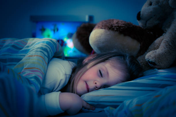 little girl sleeping stock photo