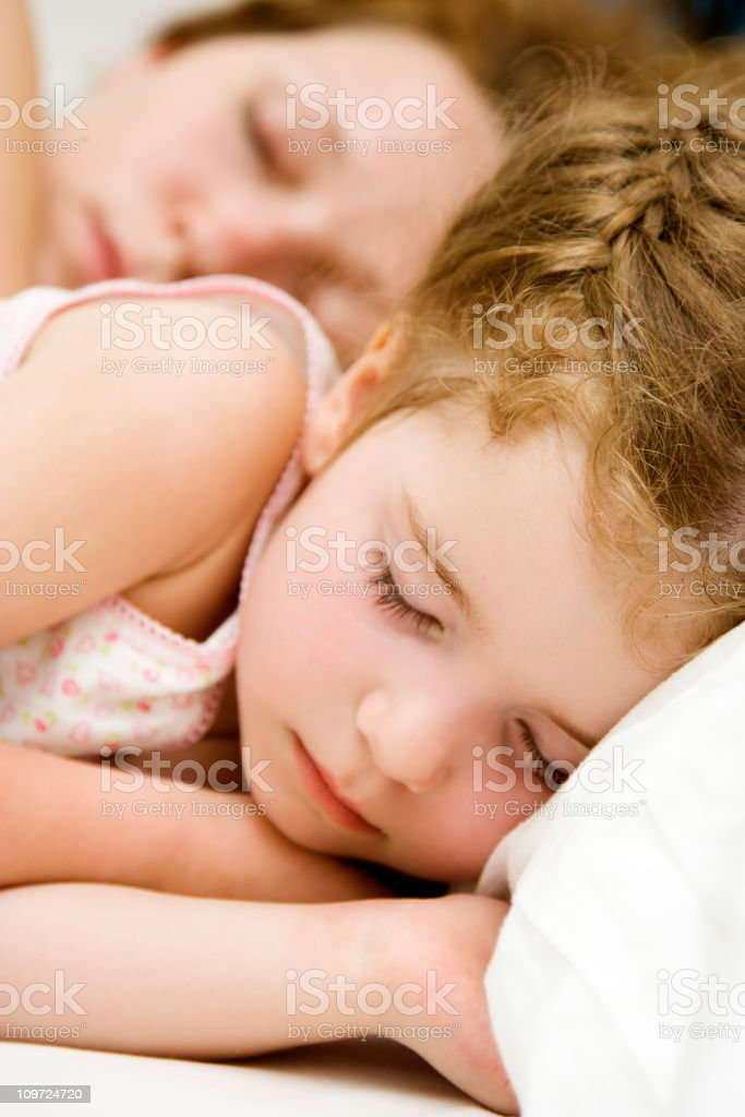 Little Girl Sleeping With Mother in Background royalty-free stock photo
