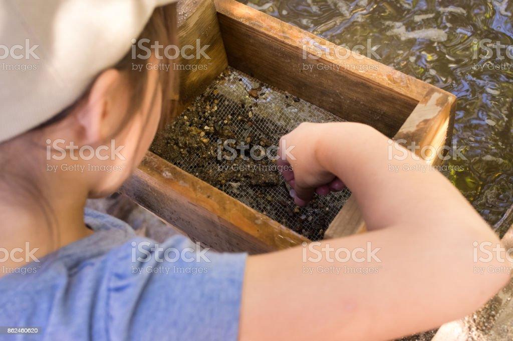 Little girl sluicing for gems in Julian, CA