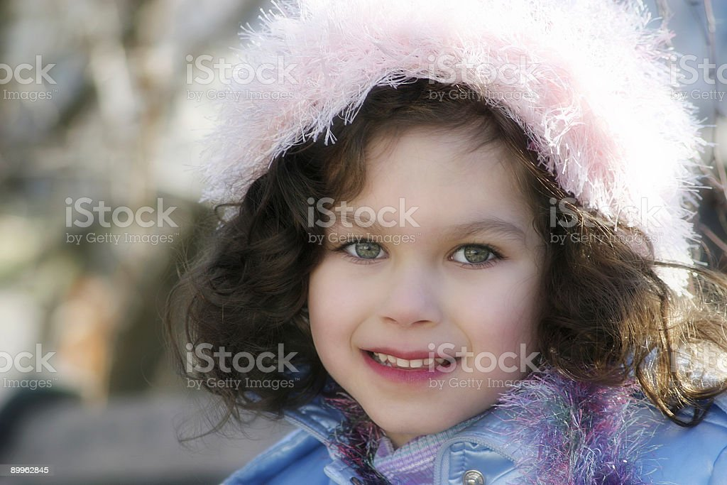 Little Girl Smiling Outdoors Winter stock photo