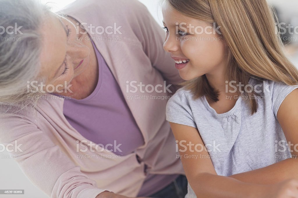 Little girl smiling up at grandmother royalty-free stock photo
