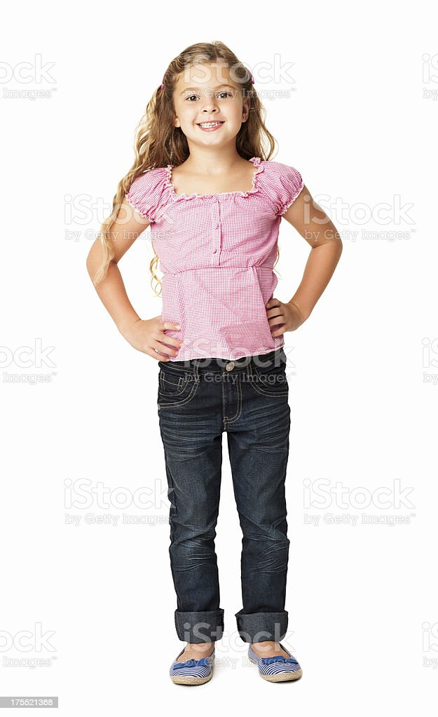 Little Girl Smiling With Hands On Hip - Isolated stock photo
