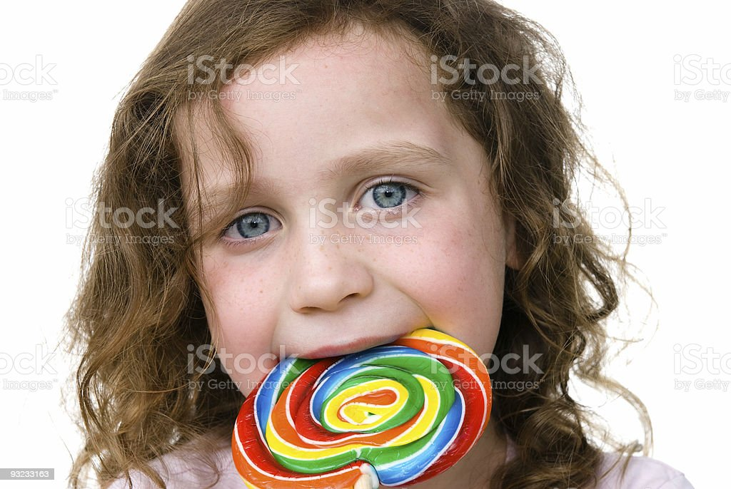 Little girl smiling with her candy pin wheel sucker royalty-free stock photo