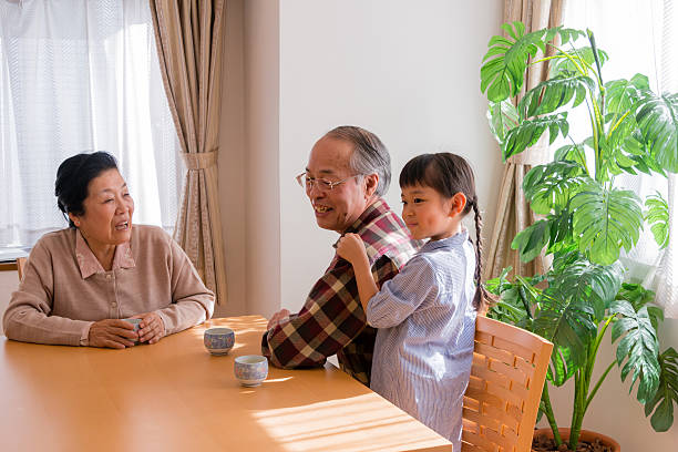 Little girl smiling with her grandparents stock photo