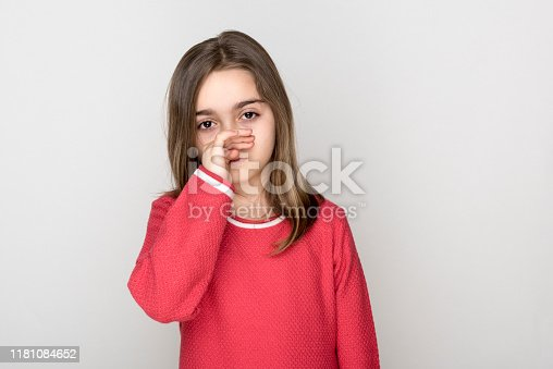 Young girl about to sneeze