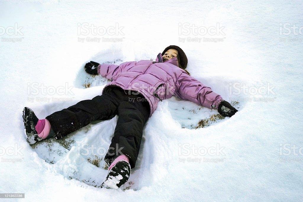Little Girl Snow Angel royalty-free stock photo