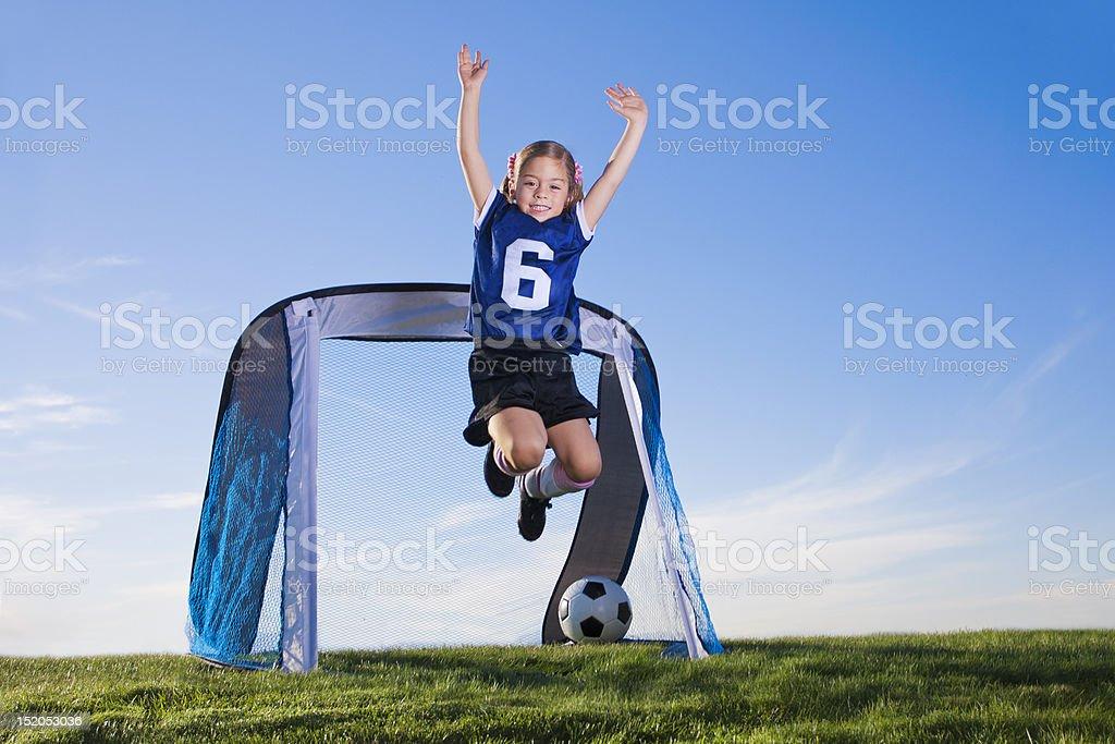 Little Girl soccer player celebrating royalty-free stock photo