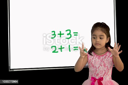 157230867istockphoto Little girl solving mathematical addition 1033270964