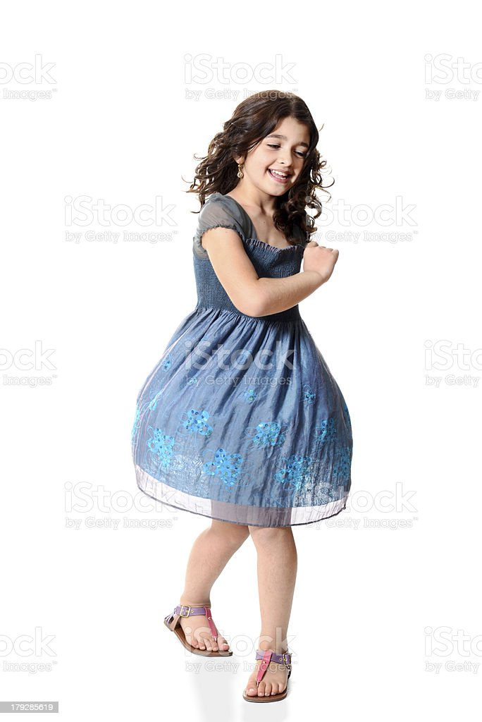little girl spinning with blue dress stock photo
