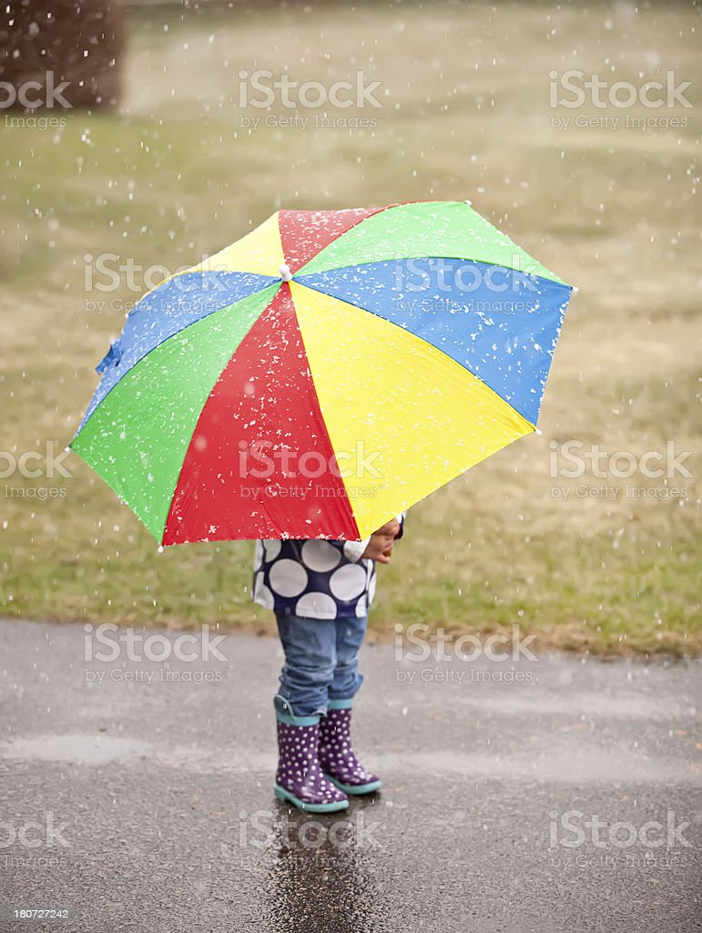 Little Girl Standing Behind Umbrella royalty-free stock photo