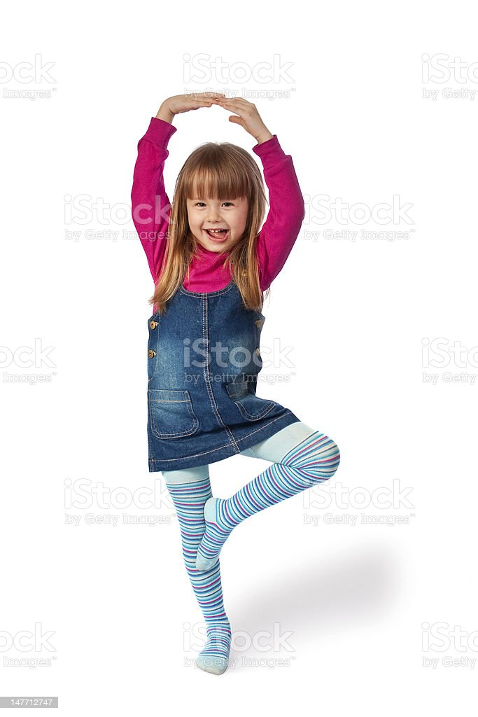 little girl standing on one leg, isolated stock photo