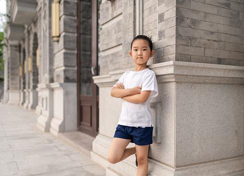 Little girl standing on retro style street