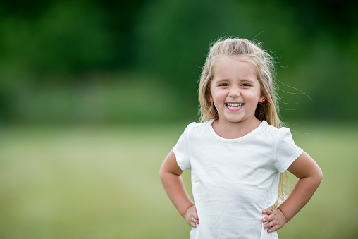 Little Girl Standing Outside at the Park